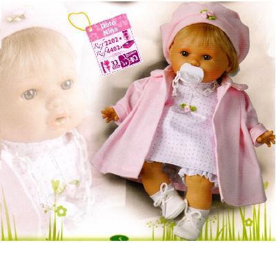 Bambola con vestitino bianco